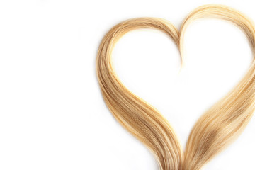 strand of blond hair isolated on white. Curls of hair in the shape of a heart