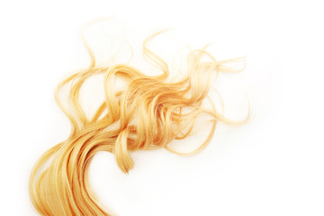 Golden Curls hair isolated on white background. strand of Blonde or red hair, hair care