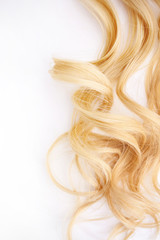 Golden Curls hair isolated on white background. strand of Blonde hair, hair care