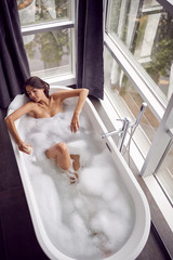 girl in bath drink champagne and relaxing top view.
