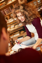 Young woman learn with male in library