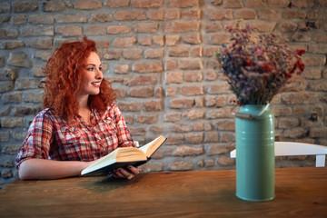Redhead girl read book