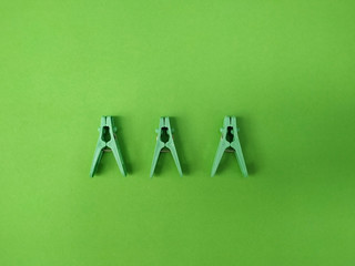 flat lay of clothespins are on green background