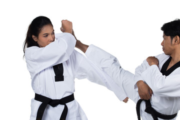 Two Master Black Belt TaeKwonDo handsome Asian Teacher man and caucasian Beautiful competitor woman fighter show hit fighting pose, self defense, studio lighting white background isolated