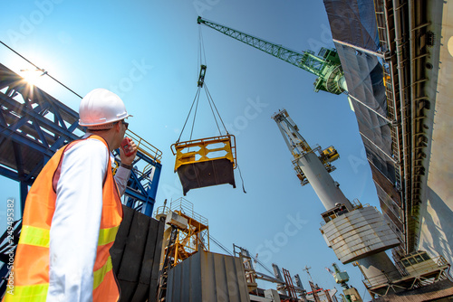engineering, loading master connecting with gantry crane driver by
