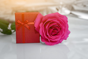One Roses and present box. - Valentines and 8 March Mother Women's Day concept.