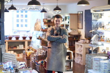 Portrait Of Smiling Male Owner Of Delicatessen Shop Wearing Apron