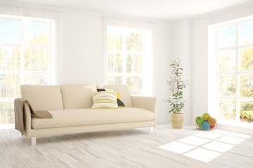 White stylish minimalist room with sofa and autumn landscape in window. Scandinavian interior design. 3D illustration