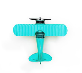 teal Metal toy plane isolated on white