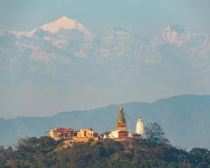 Swayambhunath stupa also called Monkey Temple in Kathmandu, Nepal. In the background the Langtang range, a subrange of the Himalayas.