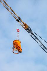 construction crane lifting concrete