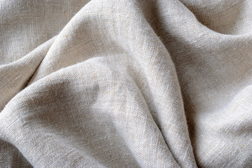 Foto op Canvas Stof Gathered and folded texture of woven linen fabric