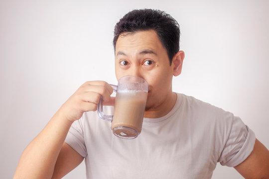 Asian Man Drinking Iced Coffee