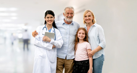 Doctor with happy family of mother, father and daughter at the hospital. Medical healthcare and doctor service.