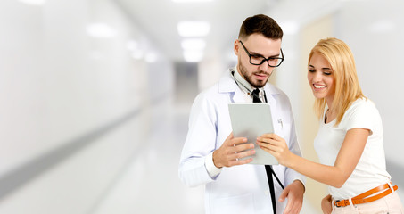 Doctor talking to patient in the hospital. The happy patient is listening to explanation from the doctor. Concept of medical healthcare and doctor staff service.