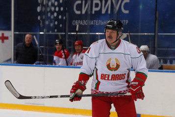 Russian President Vladimir Putin plays ice hockey