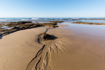 Traces in the sandy beach in summer