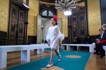 A girl walks the runway during a rehearsal for Kids Fashion Week Paris in Paris