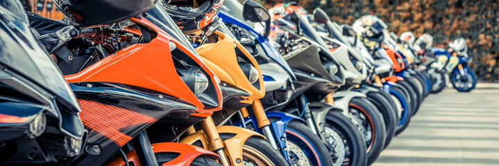 Motorcycles group parking on city street during adventure journey. Motorcyclists community travel...