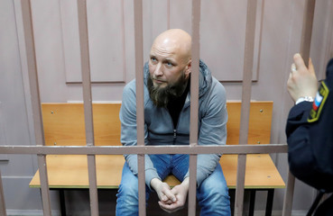 First Collection Bureau CEO Maxim Vladimirov attends a court hearing in Moscow