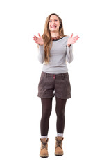 Excited expressive young cute woman smiling and giving standing ovations applause. Full body isolated on white background.