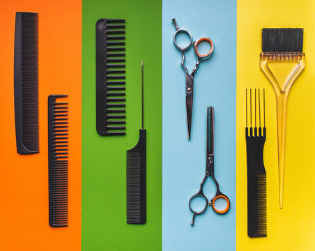 Eight tools hairdresser on the background of pastel paper in the form of multi-colored stripes. Minimalist pop art concept. Barbershop.
