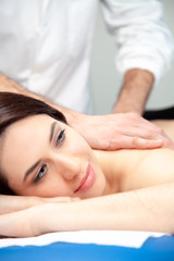 physiotherapist practices a massage on a woman's back