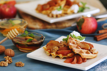 waffles sered with walnuts, honey and baked aples