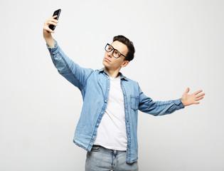 young handsone man take selfie