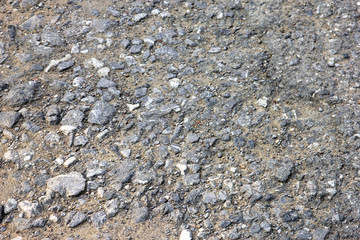 best texture of grey rocky road surface with small pebbles closeup
