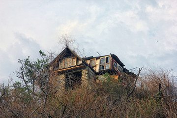 abandoned dilapidated old shack house of poor man made of all kind garbage