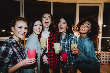 Happy female having revelry at night club