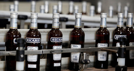 Bottles of Ricard's aniseed-flavoured beverage are pictured at the Ricard manufacturing unit in Lormont, near Bordeaux