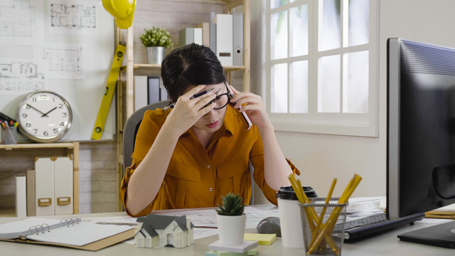 Frustrated female entrepreneur on phone call hand cover forehead feels unbelievable. Young woman architect unhappy with build worker in construction. Freelance business owner received bad news.