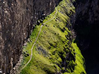 Hiking trail along the canyon wall at Palouse Falls State Park, WA, USA
