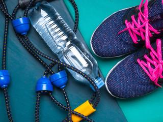 sport set with women sneakers, expander, bottle of water