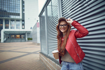 Beautiful young lady in cap spending time outdoors