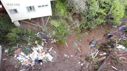 Residential properties are seen damaged after floods and mudslides in Sausalito