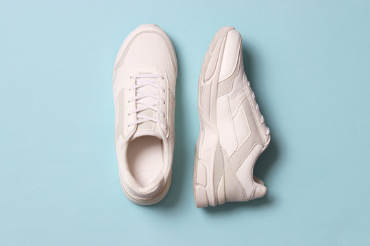 women's sneakers on a colored background top view. Women's shoes.