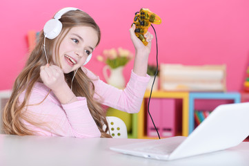 Portrait of cute  girl playing computer game