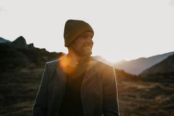 Mature man travelling through Switzerland, standing in nature
