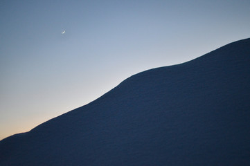 moon in the sky and fresh snow