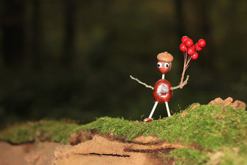 Crafted chestnut male with balloons