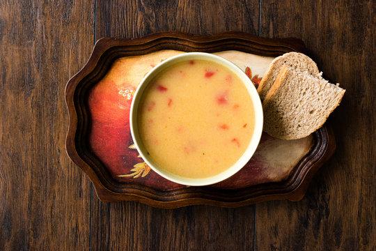 Homemade Potato Pumpkin Soup served with Bread.