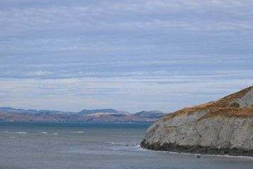 As the tide goes out the coast of the sea is more visible in Gisborne, New Zealand.