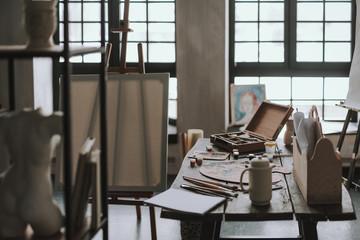 Art studio at daytime with painting equipment