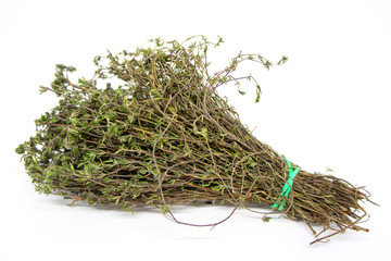 A bunch of aromatic dried thyme on white background for cooking