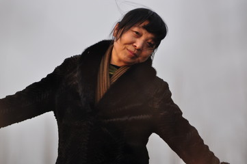 A middle-aged Asian woman