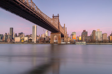 Queensboro bridge view from east river at sunrise with long exposure