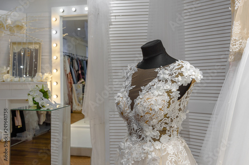 c23e591f8 Beautiful bridal dress on mannequin in modern wedding showroom ...